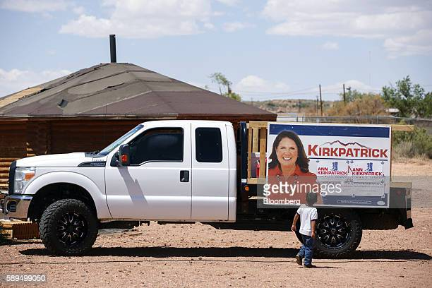 A child looks at campaign signage during an event for Representative Ann Kirkpatrick a Democrat from Arizona not pictured on the Navajo Nation Native...