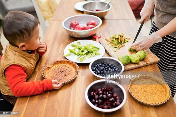 Child looks at fresh fruits