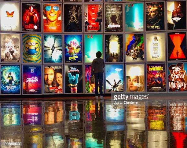 CA MARCH 12 2020 A child looks at movie posters inside the lobby of the Arclight movie theater In Manhattan Beach Ca March 122020 The industry is...