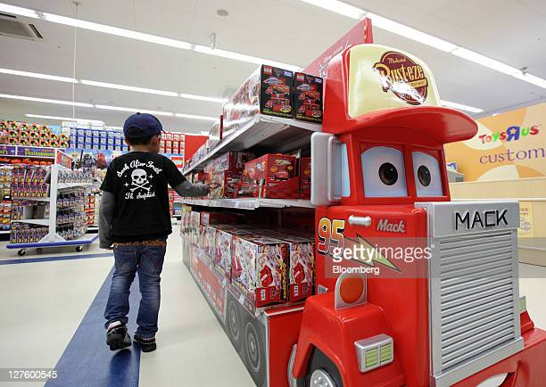 A child looks at toys at a Toys 'R' Us Inc store in Sendai City Miyagi Prefecture Japan on Thursday Sept 30 2011 Toys 'R' Us Inc is the world's...