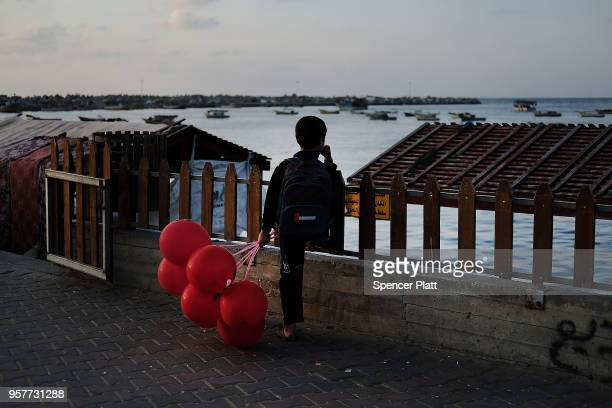 A child looks out at the sea at a fishing port on May 12 2018 in Gaza City Gaza Tensions are high along the GazaIsrael border following more than a...