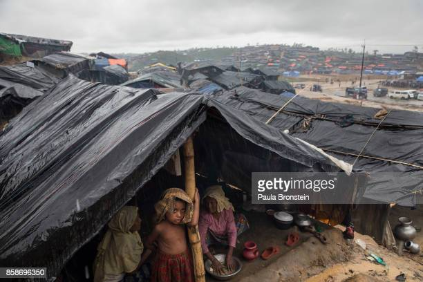 Child looks out from his tent while monsoon rains continue to batter the area causing more difficulties October 7, Thainkhali camp, Cox's Bazar,...