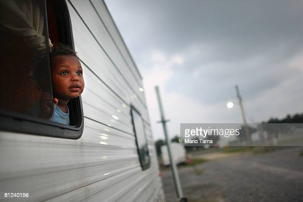 Child looks out of a trailer in the FEMA Diamond travel trailer park May 26, 2008 in Port Sulphur, Louisiana. Phillips lost her home and job in...