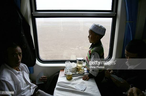 A child looks out of a window of a train from Lanzhou of Gansu Province heading to Lhasa August 22 2006 in Amdo County of Tibet Autonomous Region...
