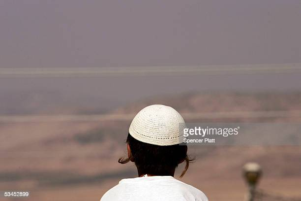 A child looks out over the landscape moments before being evacuated August 23 2005 in the West Bank settlement of Sanur Sanur was one of four West...