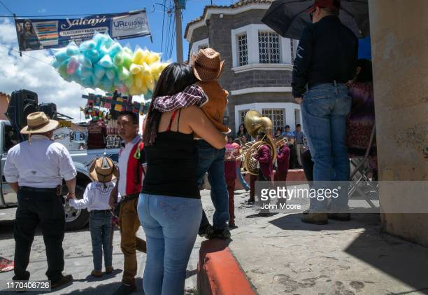 A child looks towards a remittance house during a festival on August 25 in Salcaja Guatemala Neighbors said the home was built by money sent back...