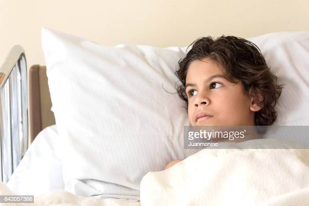 Child lying in hospital bed