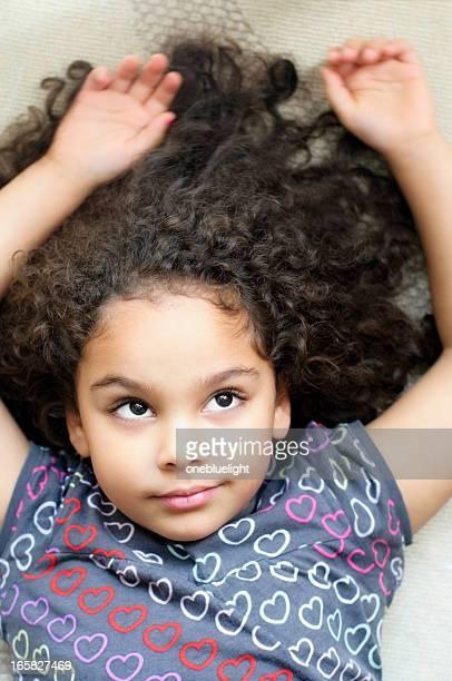 child (5-6) lying on floor, daydreaming - alleen kinderen stockfoto's en -beelden