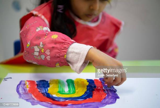 Child maintains social distancing measures while painting a rainbow during a lesson at Earlham Primary School, which is part of the Eko Trust on June...