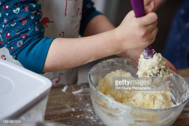 child making a cake - preparation stock pictures, royalty-free photos & images
