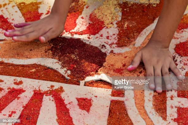 child making alfombras (sawdust carpets) - karwoche stock-fotos und bilder