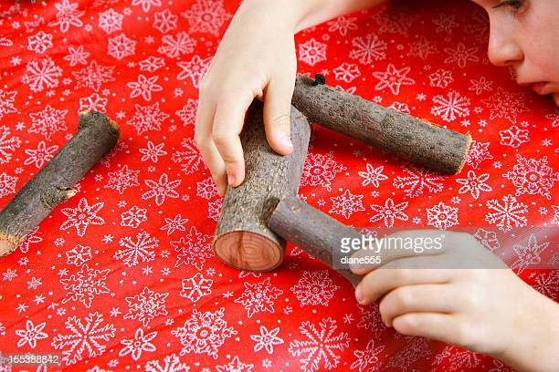 Child making Homemade Reindeer Ornaments