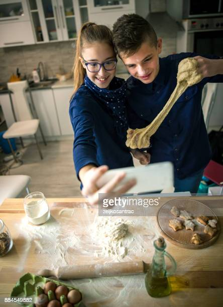 Child  making selfie while cooking at home