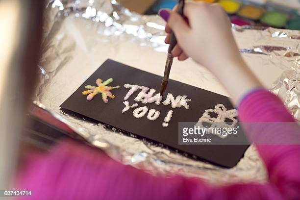 Child making 'Thank You' card