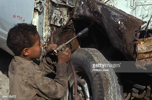 child mechanic with blow torch - child labour stock pictures, royalty-free photos & images