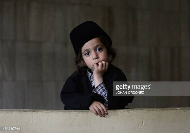 A child member of an ultraOrthodox Jewish group looks on at the building where the group will remain in Guatemala City on September 2 2014 230...