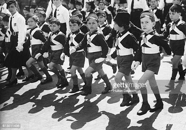 Child members of the Les Fils de la Lonue military organization take part in a fascist demonstration in Italy ca 1943