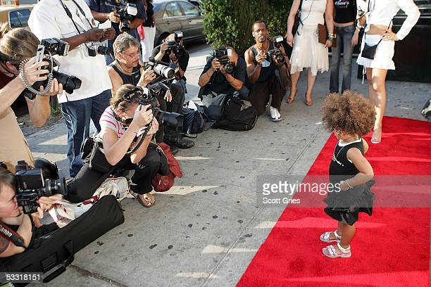 Child model Darly Murray is photographed on the red carpet arriving at a fashion show and party to benefit the Make A Wish Foundation at The Park...