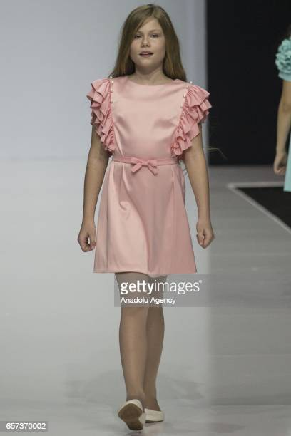 A child model presents a creation of Funny Sunny during the 2017/2018 Fall/Winter Moscow Fashion Week in Gostiny Dvor in Moscow Russia on March 24...
