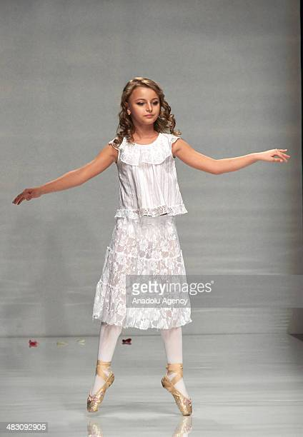 A child model presents creation of 'Zhanna Volska' collections during the Saint Petersburg Fashion Week in Russia on April 5 2014