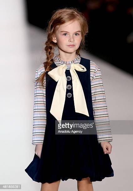 A child model presents 'Lower grades school uniform' collections during the MercedesBenz Fashion Week Russia at Manezh Central Exhibition Hall in...