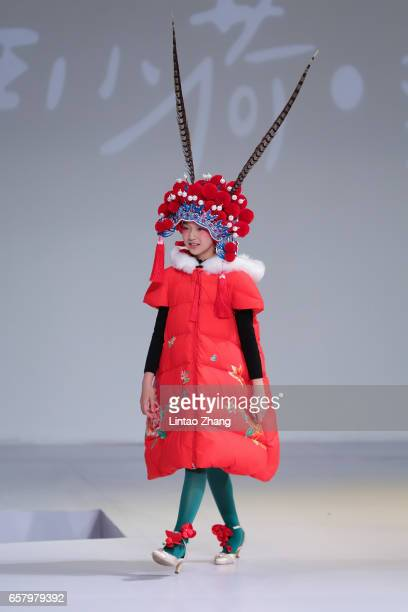 A child model showcases designs on the runway at Designer Fan Chung works released Show during the MercedesBenz China Fashion Week Autumn/Winter...