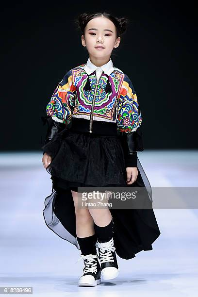 A child model walks the runway at JOJO by Wei Sun show during MercedesBenz China Fashion Week Spring/Summer 2017 at 751D park on October 26 2016 in...
