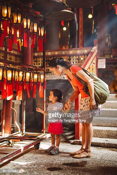 Child & mom looking at lanterns in Chinese temple