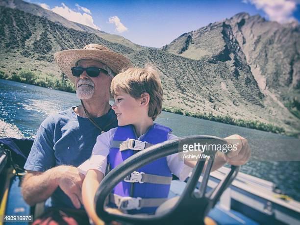 Child Mountain lake boating with Grandpa
