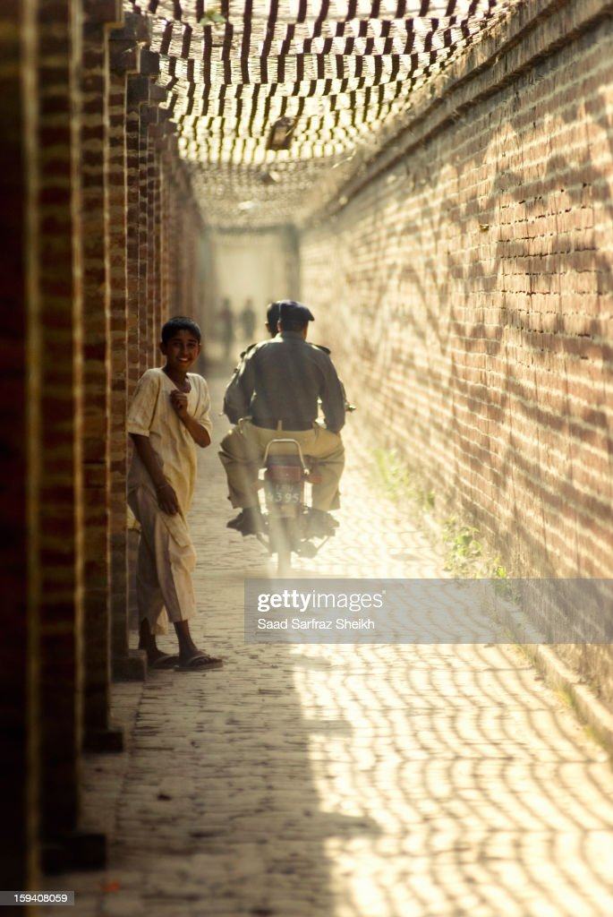 CONTENT] A child moves to the side just in time to avoid being hit by the Police bike. His smile is victorious. This is the ancient passage that leads to Mughal architect Ali Mardan's tomb in Mughalpura, Lahore