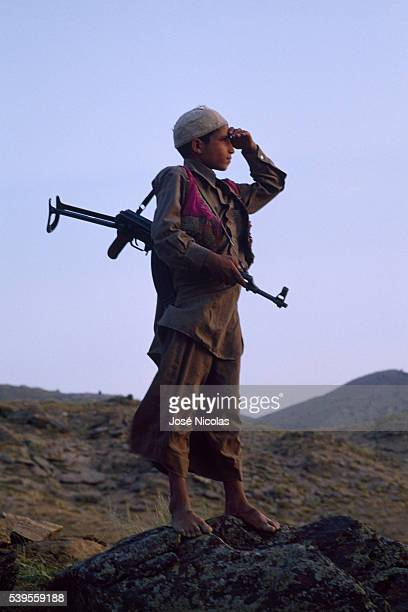 Child mujahid member of the Pashtun people during the war in Afghanistan Forced workers sex slaves soldiers despite themselves aged 5 to 14 these...
