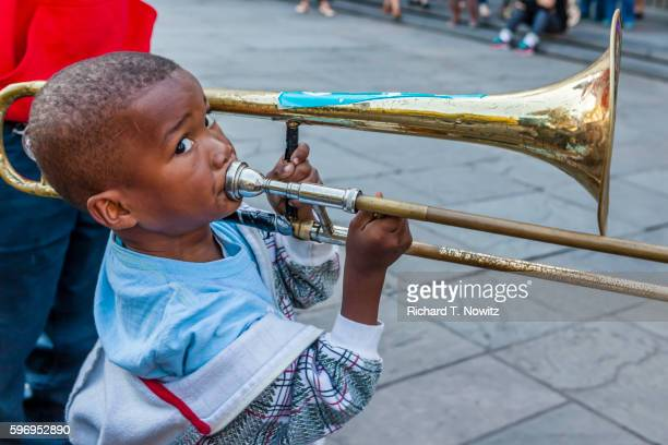 Child Musician plays in Jackson Sq