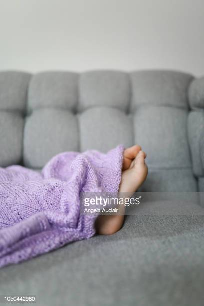 Child Napping with Feet Uncovered