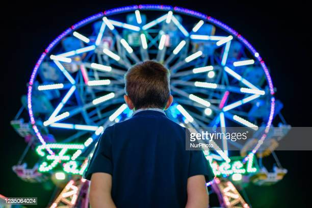 Child observes the Ferris wheel in operation, on the first day of the Luna Park opening in Molfetta on 4 September 2021. On the occasion of the...