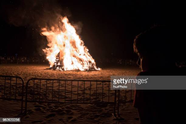 A couple of young people kiss during the night of San Juan on the beach of Santander Spain on June 23 2018 The Night of San Juan is by far the most...
