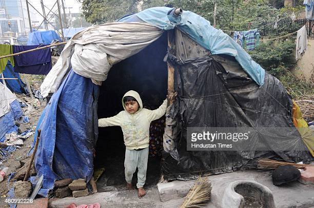 A child of a homeless family play by their roadside shanty during a cold and foggy day on January 3 2015 in Noida India Delhi NCR has a homeless...