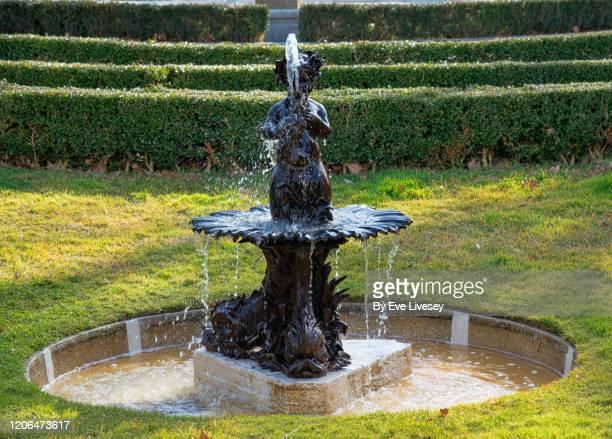child of poseidon fountain in el buen retiro park - fountain stock pictures, royalty-free photos & images