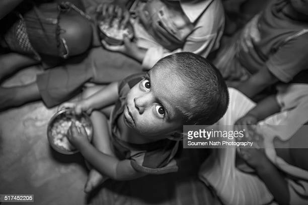 child of poverty stricken family - malnutrition stock pictures, royalty-free photos & images