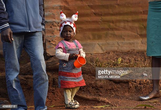 A child of the Fouh district in Bangui wears a Christmas hat on December 28 2013 French and African troops including a Chadian contingent are...