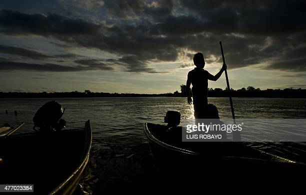 A child of the Wounaan Nonam indigenous ethnic group remains in a canoe in the San Juan river during the 10th Meeting of the Ancestral Knowledge of...