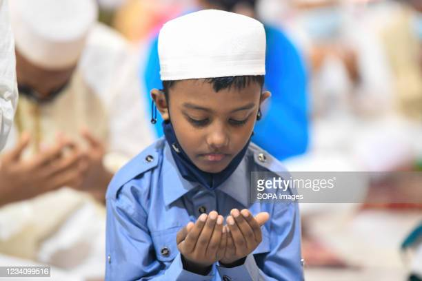 Child offers prayers to mark the start of the Muslim festival Eid al-Adha or the 'Festival of Sacrifice at Baitul Mukarram National Mosque in Dhaka.