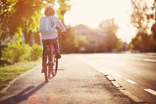 child on a bicycle 1044748302