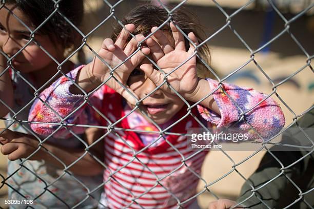 Child on a fenced playground in refugee camp Zaatari on April 04 2016 in Amman Irbid