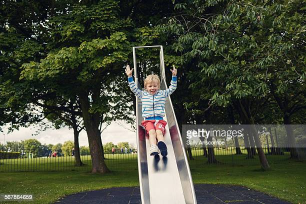 Child on a slide at the park