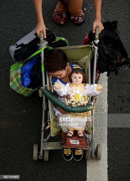 A child on a stroller sleeps beside a religious icon of the baby Jesus Christ during the annual Grand Santo Nino Procession in Manila on January 27...