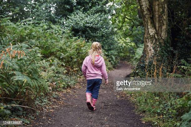 child on a walk in the woods - wellington boot stock pictures, royalty-free photos & images