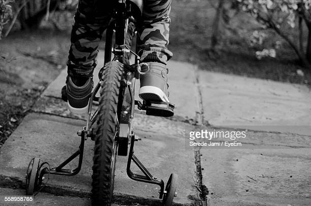 Child On Bicycle With Training Wheels