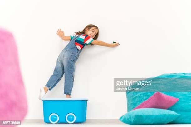 Child on empty wall copy space