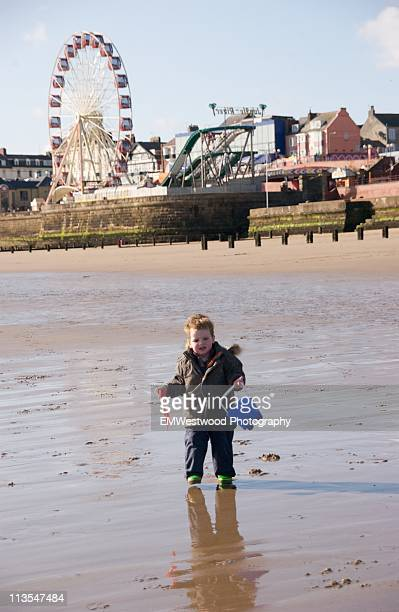 child on scarborough beach - scarborough uk stock pictures, royalty-free photos & images