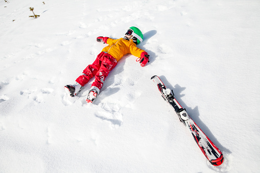 Child on snow with snowboard - gettyimageskorea